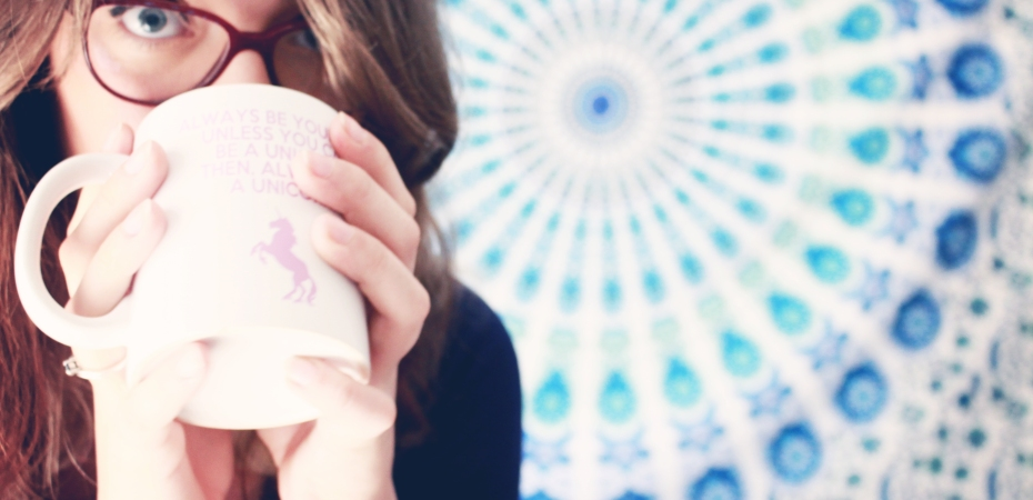 Blogger with cup that reads: Alway be yourself, unless you can be a unicorn, then always be a unicorn