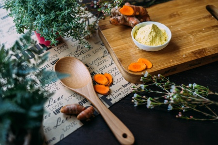 Kitchen counter with utensils, turmeric and herbs