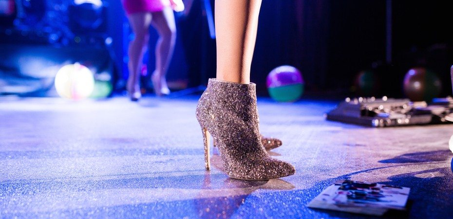 Woman standing in glitter ankle boots