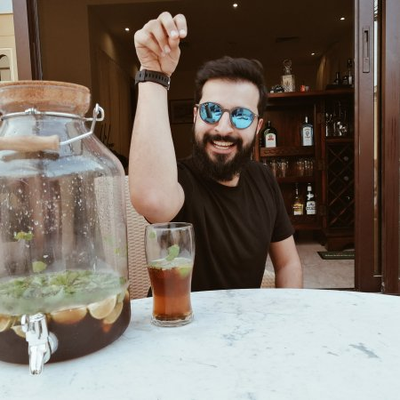Guy posing with Thid Culutre Kid cocktail glass and jug